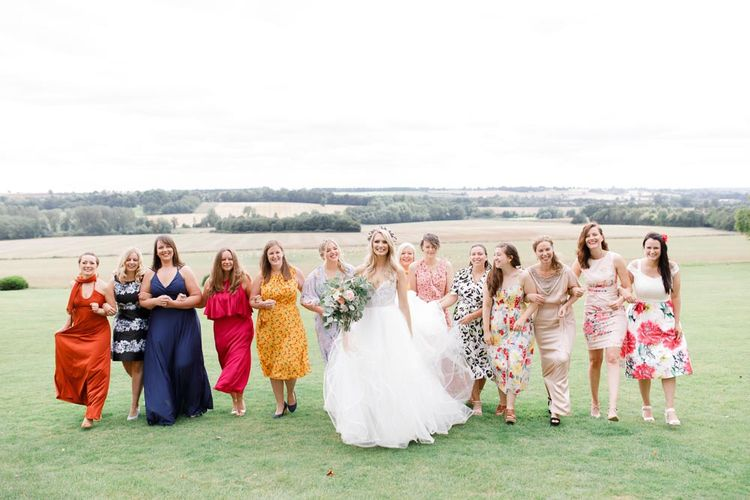 Bridal with guests at Aynhoe Park wedding venue