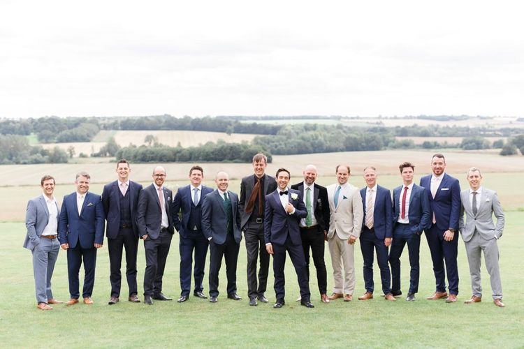 Groom with guests at Aynhoe Park wedding venue