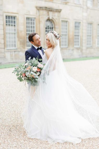 Lace wedding dress with big bouquet at whimsical wedding