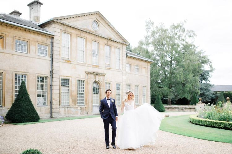 Bride and groom in front of Aynhoe Park wedding venue in Cotswolds