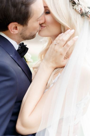 Bride and groom steal a kiss