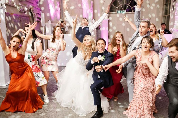 Bride and groom enjoy a dance with their friends and family