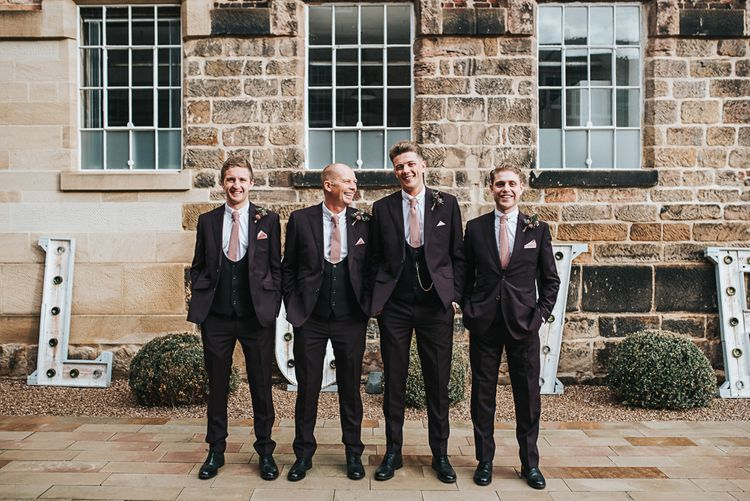 Groomsmen in Tailor Me Moss Bros. Three-piece Suits with Horseshoe Waistcoat