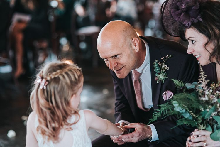 Father of the Bride and Flower Girl Talking During the Wedding Ceremony