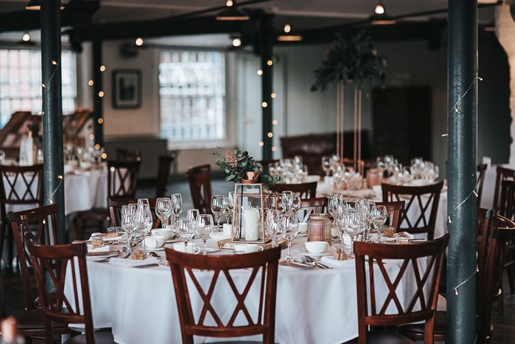 Copper Centrepiece Wedding Reception Decor at Industrial Venue The West Mill in Derbyshire