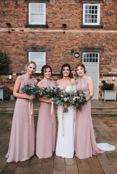 Bridal Party with Bridesmaids in Mauve TFNC Dresses and Bride in Lace Bardot Wedding Dress