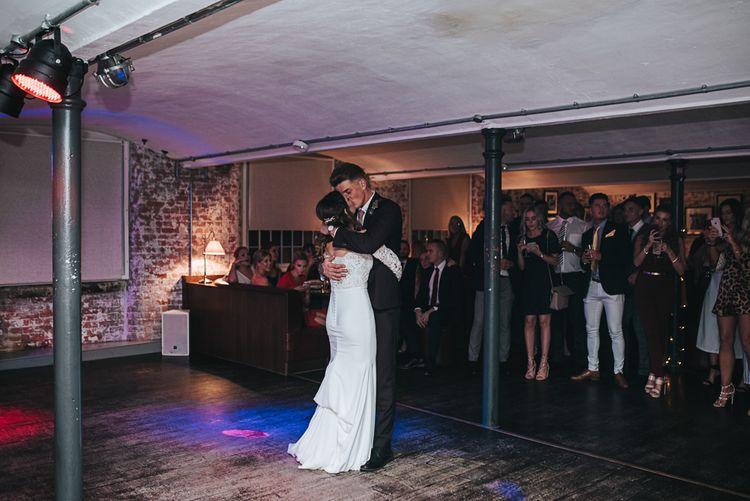 First Dance with Bride in Pronovias Dracma Bardot Wedding Dress and Groom in Tailor Me Moss Bros. Suit