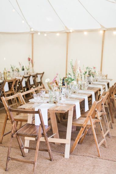 Wooden Trestle Tables For Marquee Wedding // Needle & Thread Bridesmaids Dresses For A Pink And Mint At Home Marquee With Fine Art Photography From Amy Fanton Photography