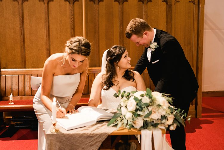 Wedding Ceremony | Signing The Register | Bride in Badgley Mischka  Lace Bridal Gown | Groom in Black Tie | Elegant Grey, Green, White & Gold Black Tie, Marquee Wedding at Tullyveery House N. Ireland with Decor & Styling by Mood Events | The Lou's Photography | Soul & Rise Film
