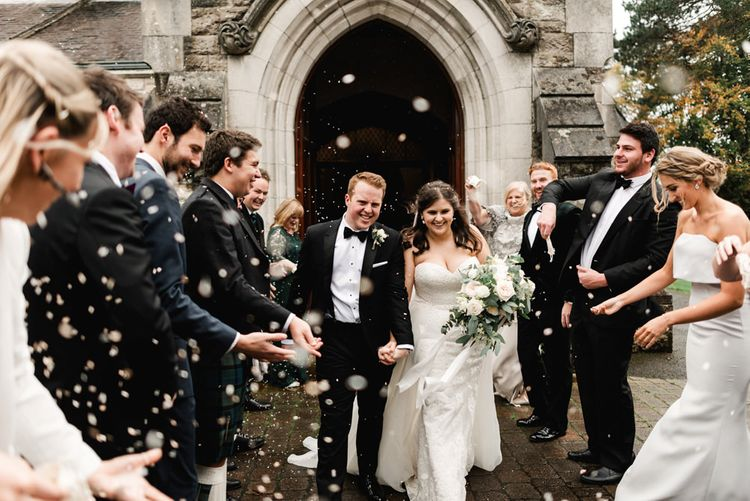 Confetti Exit | Bride in Badgley Mischka  Lace Bridal Gown | Groom in Black Tie | Elegant Grey, Green, White & Gold Black Tie, Marquee Wedding at Tullyveery House N. Ireland with Decor & Styling by Mood Events | The Lou's Photography | Soul & Rise Film