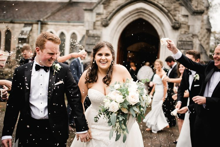 Confetti Moment | Bride in Badgley Mischka  Lace Bridal Gown | Groom in Black Tie | Elegant Grey, Green, White & Gold Black Tie, Marquee Wedding at Tullyveery House N. Ireland with Decor & Styling by Mood Events | The Lou's Photography | Soul & Rise Film