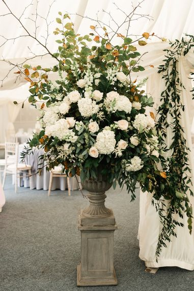 Large Floral Arrangement by Floralearth | Elegant Grey, Green, White & Gold Black Tie, Marquee Wedding at Tullyveery House N. Ireland with Decor & Styling by Mood Events | The Lou's Photography | Soul & Rise Film