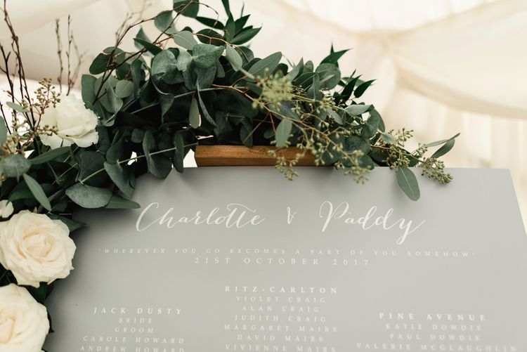 Grey Table Plan with Greenery Garland | Elegant Grey, Green Marquee Wedding at Tullyveery House N. Ireland with Decor & Styling by Mood Events | The Lou's Photography | Soul & Rise Film