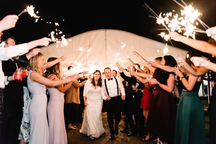 Sparkler Moment | Bride in Badgley Mischka  Lace Bridal Gown | Groom in Black Tie | Elegant Grey, Green, White & Gold Black Tie, Marquee Wedding at Tullyveery House N. Ireland with Decor & Styling by Mood Events | The Lou's Photography | Soul & Rise Film