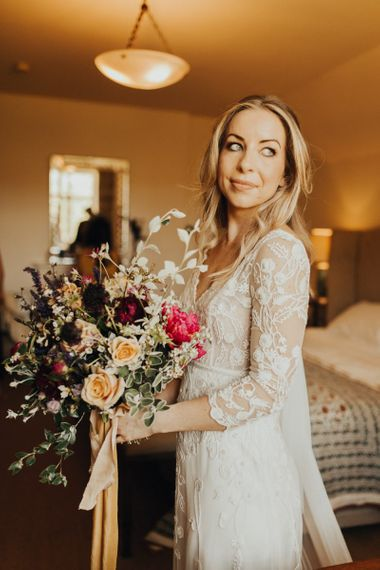 Bridal bouquet and lace wedding dress