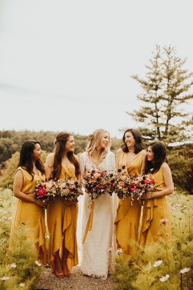 Yellow bridesmaid dresses with flower bouquets