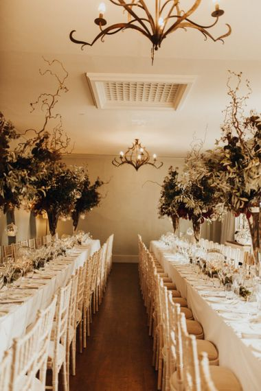Tall foliage wedding centrepiece  for Devon wedding with yellow bridesmaid dresses