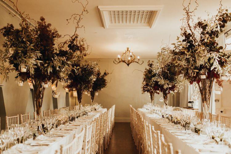 Tall foliage wedding reception decor for Devon wedding