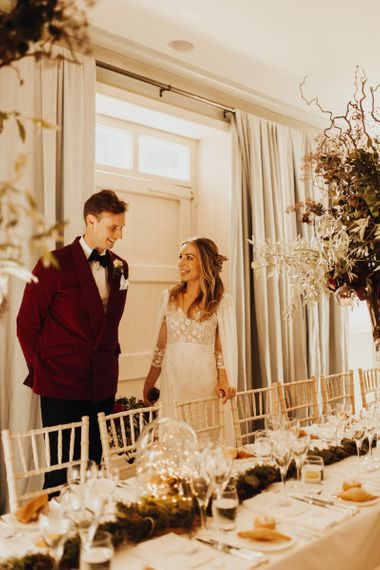 Bride and groom before reception in red dinner jacket