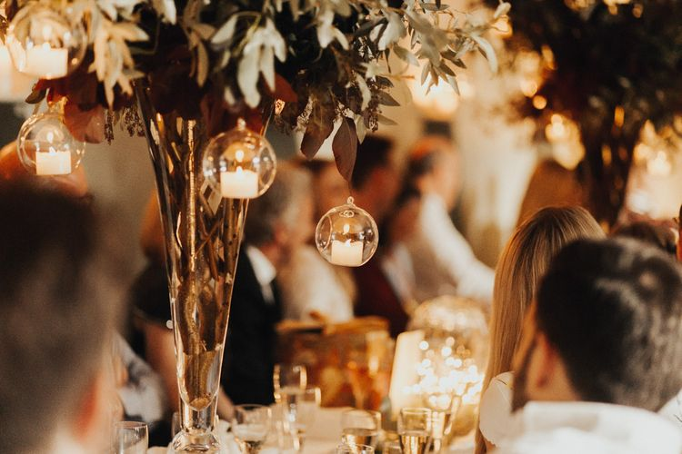 Hanging candles on wedding table decor for wedding with yellow bridesmaid dresses