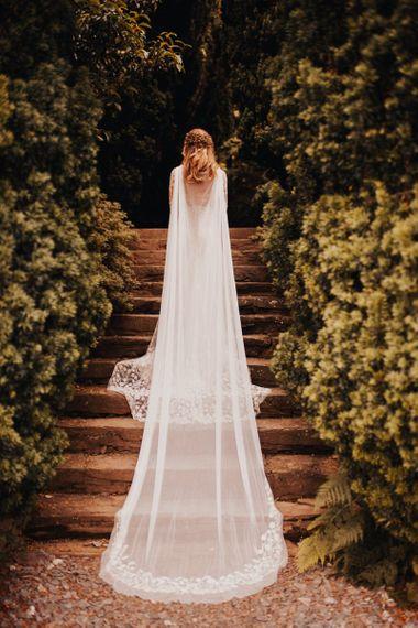 Bridal cape for stunning Devon wedding with yellow bridesmaid dresses