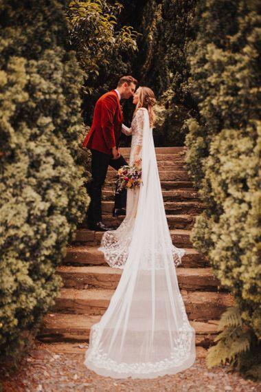 Bride in wedding cape and bespoke bride  dress