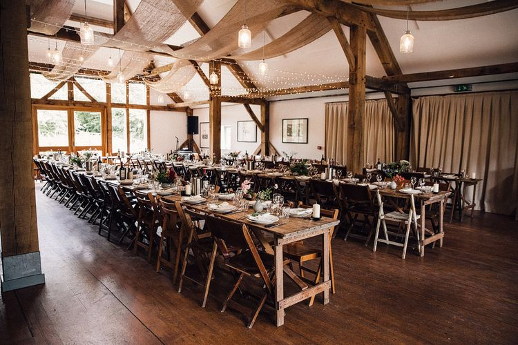 Barn wedding table set up with fairy lights