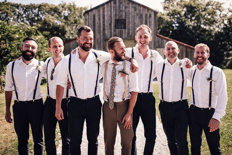 Groomsmen in matching outfits with braces