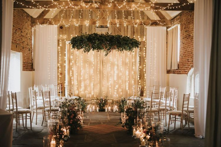 Healing Manor wedding ceremony with fairy light backdrop