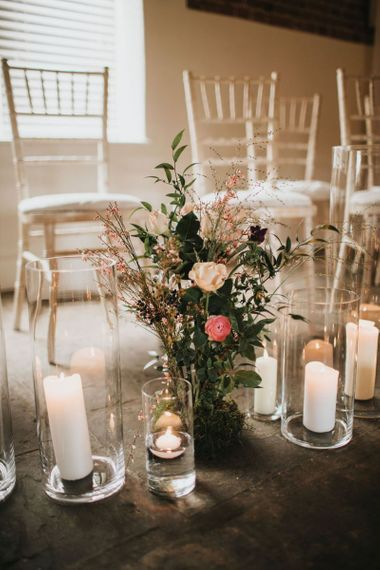 Wedding ceremony flowers and candles at Healing Manor