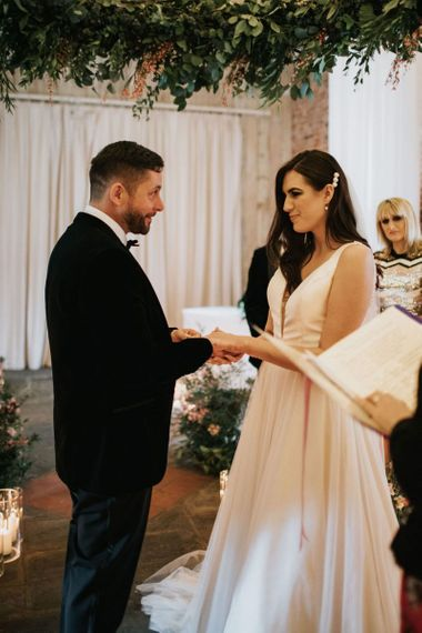 Bride and groom exchange rings at Healing Manor wedding