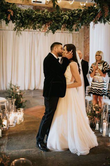 Bride and groom kiss at Healing Manor wedding
