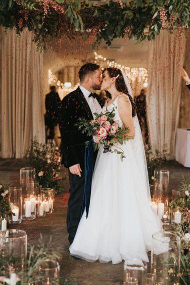 Pink bouquet with satin wedding dress
