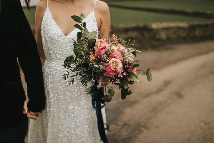 Sequin bride dress with pink bouquet