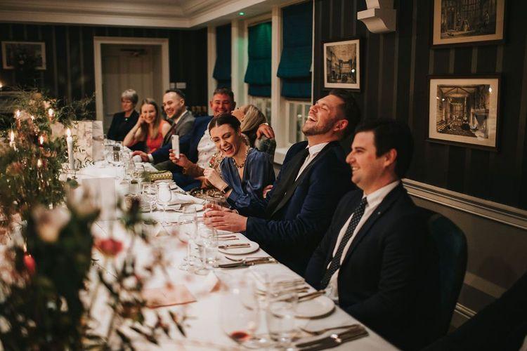Guests enjoy wedding speeches