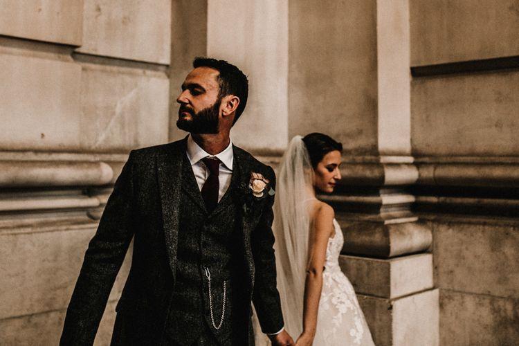 Groom in Wool Walker Slater Three-piece Suit and Bride in Hayley Paige Wedding Dress