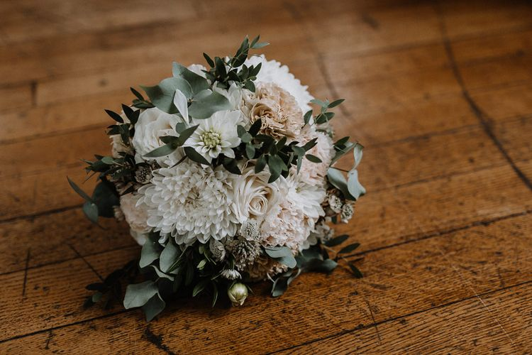 Bridal Bouquet of White and Blush Pink Flowers with Eucalyptus and Trailing Silk Ribbon | Floral Arch and Bride in Batwing Sleeve Halfpenny Dress for London Pub Wedding | Caitlin + Jones