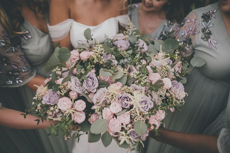 Stunning lilac wedding bouquets for bridal party at rustic barn wedding