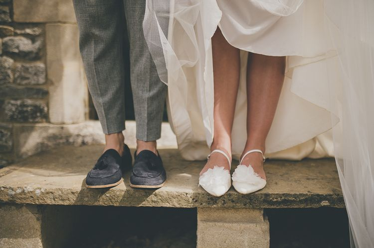 Flat wedding shoes for bride at rustic barn wedding