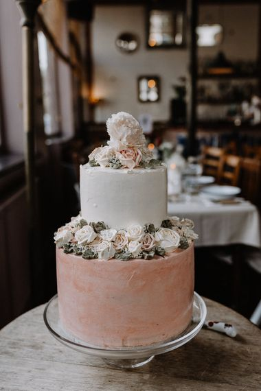 Two-Tier Wedding Cake with Buttercream Icing and Iced Flowers | Floral Arch and Bride in Batwing Sleeve Halfpenny Dress for London Pub Wedding | Caitlin + Jones