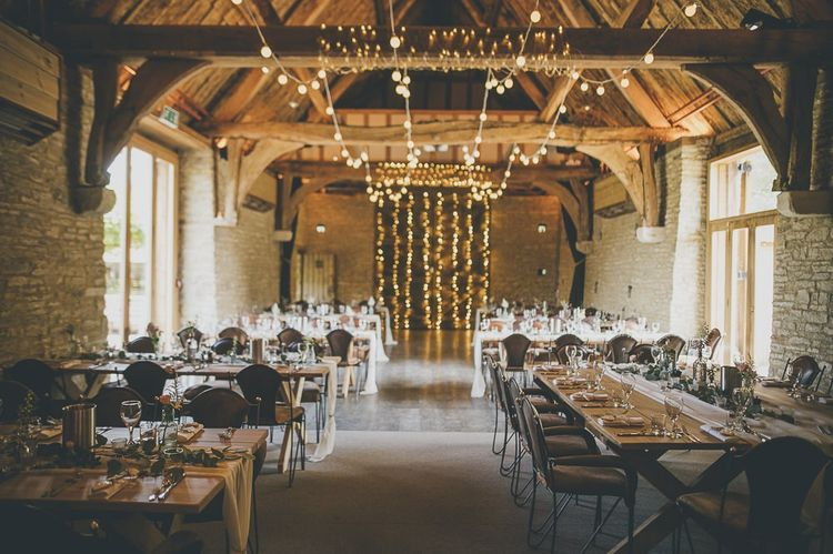 Beautiful rustic wedding venue Tythe Barn with fairy lights