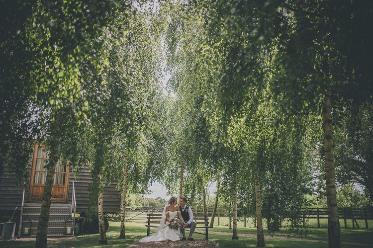 Bride and groom in ground of Tythe Barn wedding venue