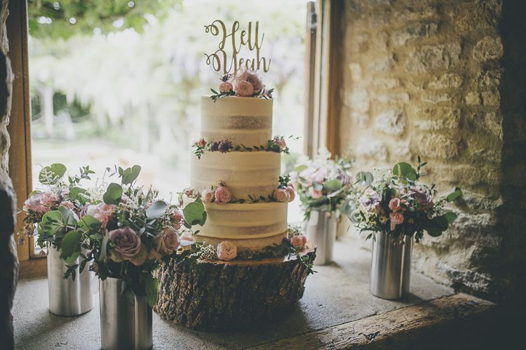 Semi-naked wedding cake for rustic barn wedding
