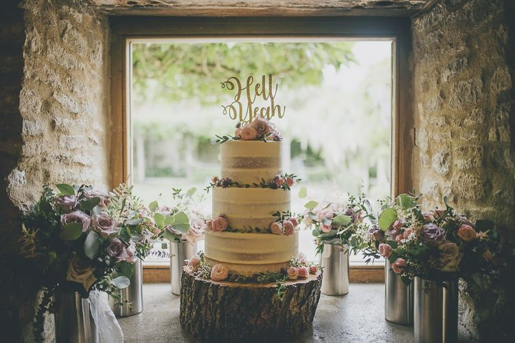 Semi-naked wedding cake with cake topper