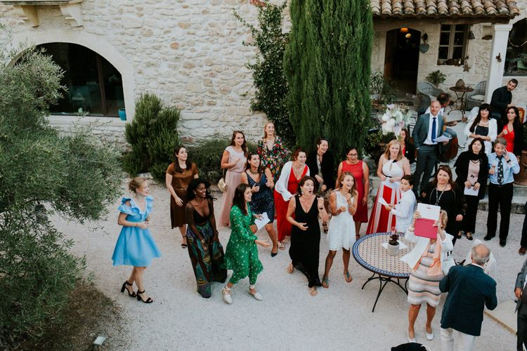 Wedding Guests Gathered in Provence Wedding Venue Courtyard