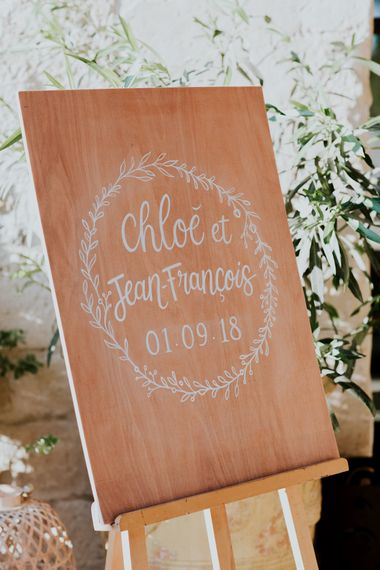 Wooden Wedding Welcome Sign with White Calligraphy and Laurel Design