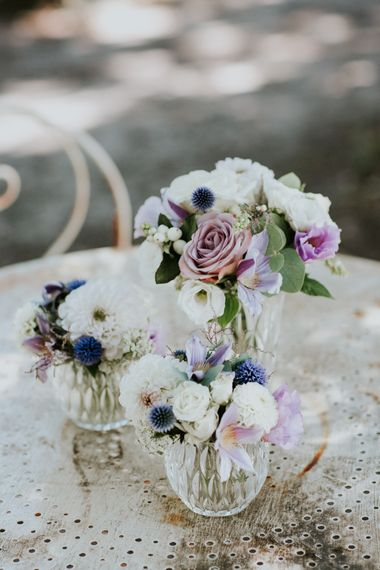 Clustered White and Lilac Wedding Flowers in Vase