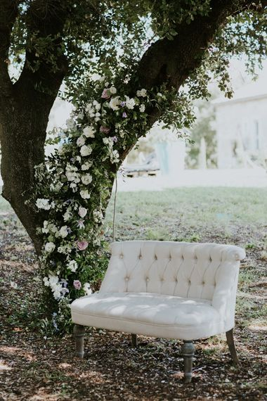 Tree Decorated in Flowers and Cream Love Seat