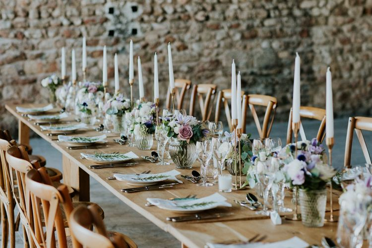 Rustic Reception Wedding Decor with Lilac Floral Centrepieces and Taper Candles
