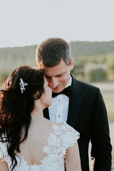 Bride in Appliqué Caroline Castigliano Wedding Dress and Groom in Tuxedo Embracing